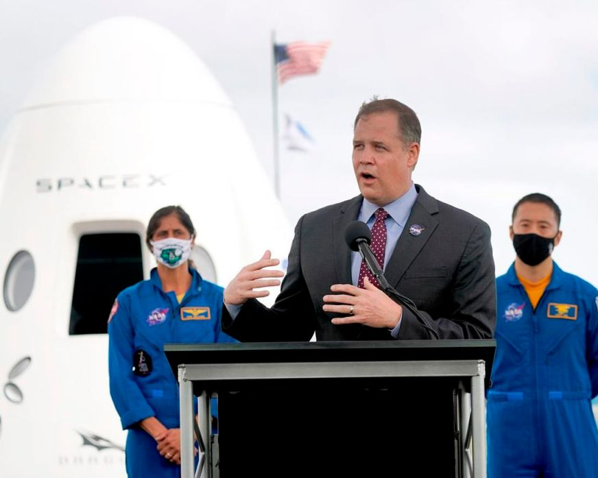 SpaceX crew flight delayed; Musk gets mixed COVID-19 ...