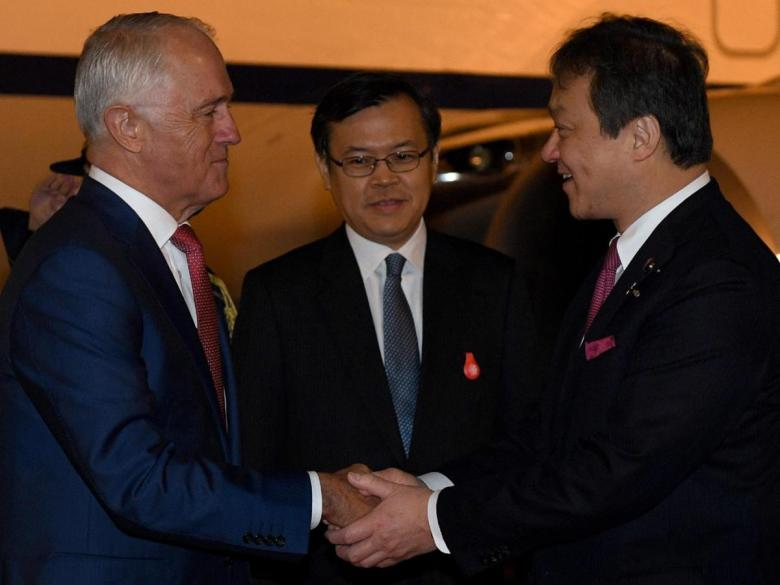 Malcolm Turnbull is greeted by Japanese Parliamentary Vice Minister of Foreign Affairs Iwao Horii (right) as he arrives at Haneda airport in Tokyo today. Picture: AAP