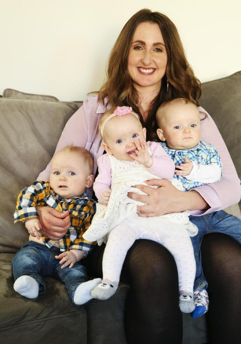 Lanai Scarr with her triplets James, Edith, and Nathaniel, at seven months, at home in Canberra.