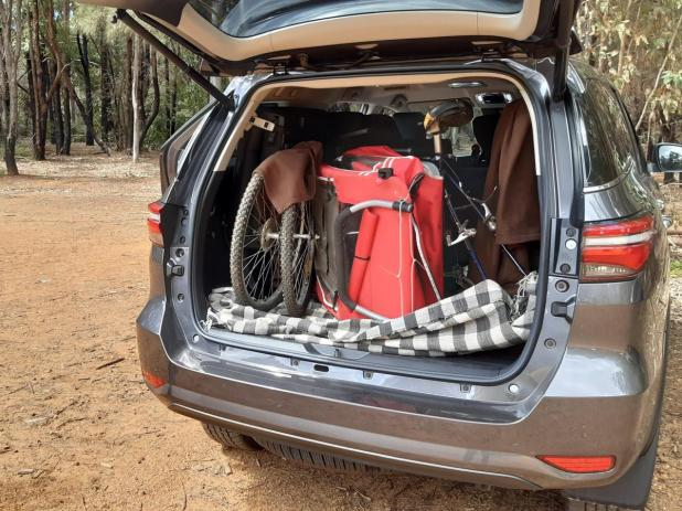 A bike and bike trailer in the Fortuner's boot.