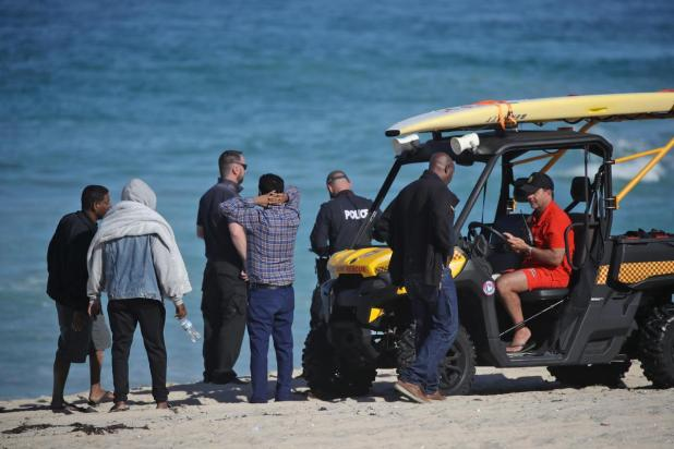 Police and surf life savers were involved in the search as friends and family watched on.