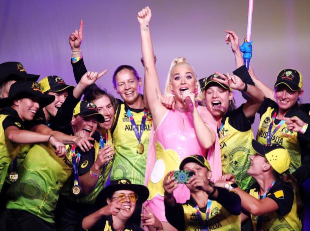 Katy Perry performs on stage with the Australian cricket team following their victory in the ICC Women's T20 Cricket World Cup Final.