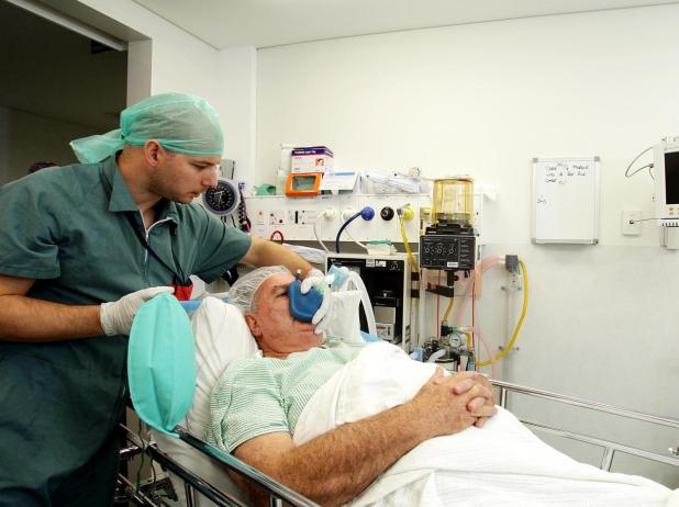 A patient is put under anaesthesia for a colonoscopy.