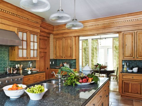 Elegant Kitchens with Warm Wood Cabinets   Traditional Home Tall Honey Cabinets With Detailing