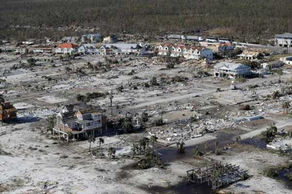 Rescuers find first body in town worst hit by hurricane ...