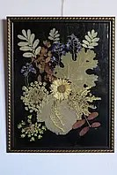 Композиція з сухих квітів та листя