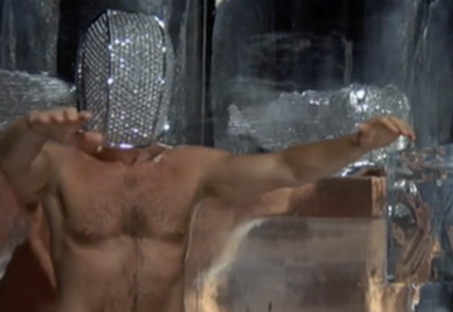 Naked man wearing a metal mask