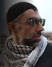Filmmaker Usama Alshaibi wearing sunglasses