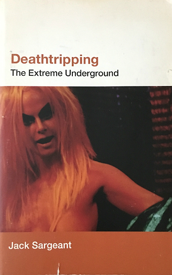 Deathtripping book cover with Kembra Pfahler in orange makeup and a fright wig