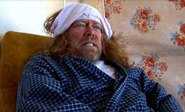 Film still of a man wearing a pair of underwear on his head
