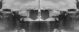 Upside down and mirrored image of a train leaving a station