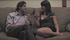 Pretty woman and well-dressed man flirt on the couch