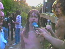 Shirtless heavy metal musician at an outdoor concert