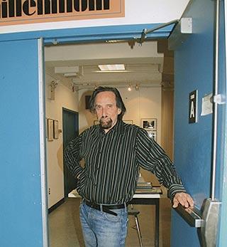 Howard Guttenplan standing in the doorway entrance to the Millennium Film Workshop