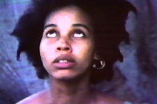 Pretty African-American woman looking upward