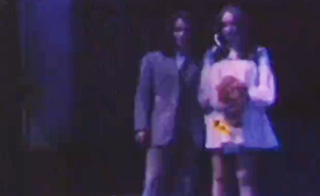A just married couple pose for a home movie