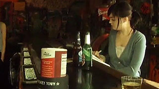 Pretty girl sitting by herself at a bar