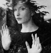 Classic image of filmmaker Maya Deren staring out a window