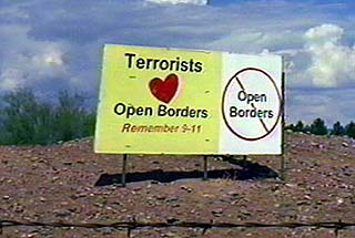 Sign that reads Terrorists (Heart) Open Borders