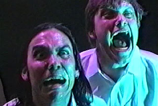 Two men scream while looking at an unseen assailant