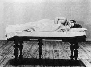 Film still from Film About a Woman Who by Yvonne Rainer featuring a couple in bed