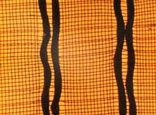 Film still from Colour Cry featuring abstract squiggly lines on a plaid background