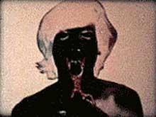 Film still of T,O,U,C,H,I,N,G by Paul Sharits featuring a man getting his tongue cut