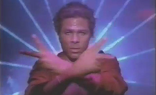 Philip Michael Thomas in front of a music video background