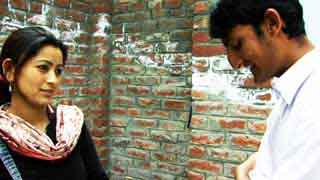 Actors Taniya Khan and Mohamad Imran Tapa talking in a scene