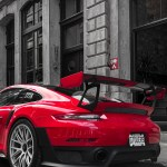 Selective Color Photography Of Red Porsche Sports Car Parked At Roadside Photo Free Image On Unsplash