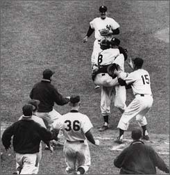 Yankees' Yogi Berra (8) jumps into the arms of Don Larsen, who retired every Brooklyn Dodger.
