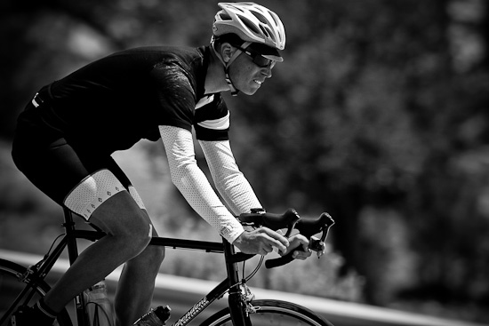Domenic descends wearing Rapha with a little Panache