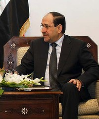 Iraq's Prime Minister Nuri al-Maliki meets with Arab League Secretary-General Nabil Elaraby at his office in Baghdad December 8, 2011.