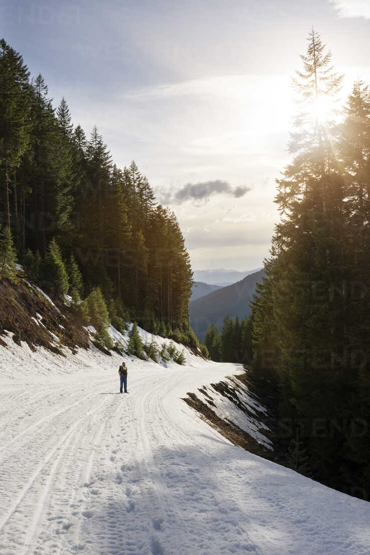 Köp böcker av pinchot gifford pinchot: Mid Distance Of Man Standing On Snow Covered Footpath On Mountain At Gifford Pinchot National Forest