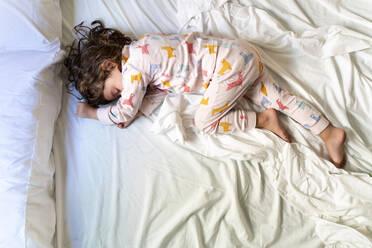 top view of cute little girl sleeping