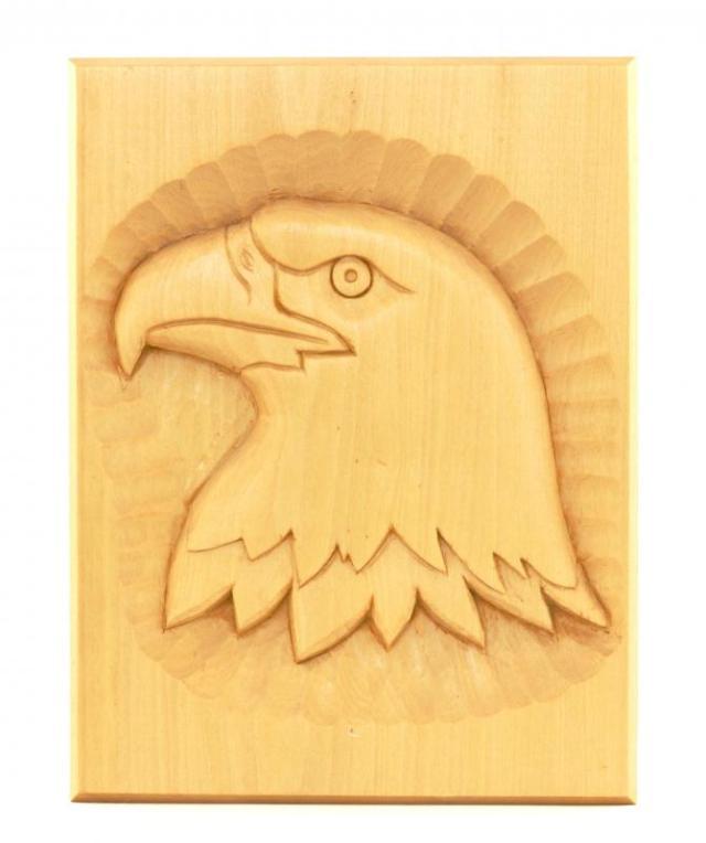 an eagle carved into balsa wood