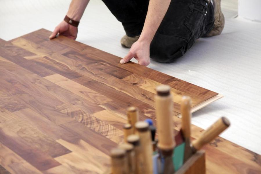 How do I Repair Water Damage to a Laminate Floor  Laminate flooring is made up of several sections locked together  making it  easier to repair small damaged sections