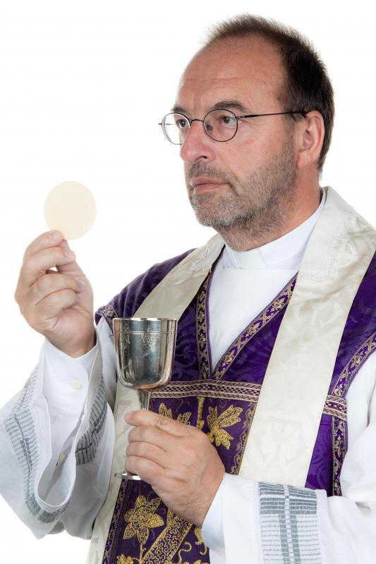 Image result for BREAD AND WINE HOLDED BY PRIEST