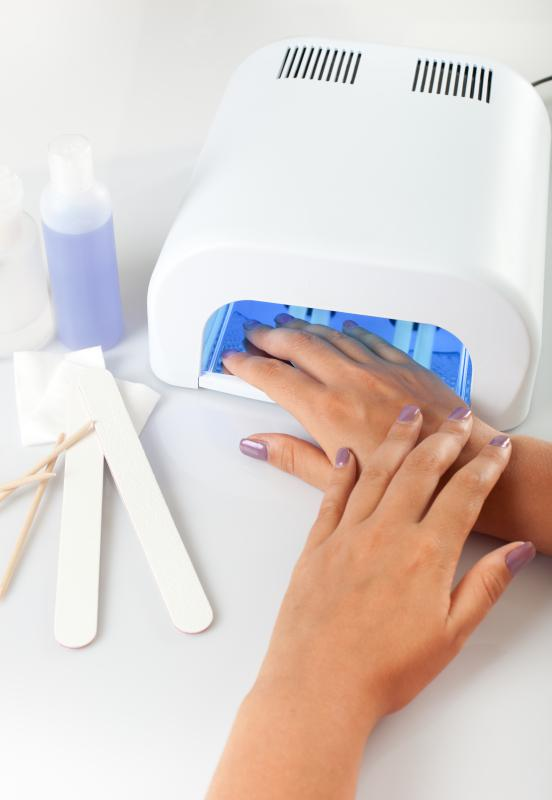 Gel Nails Curing Under A Uv Light