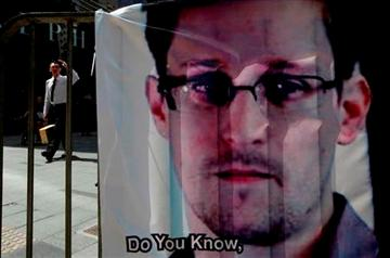 (AP Photo/Kin Cheung). A banner supporting Edward Snowden, a former CIA employee who leaked top-secret documents about sweeping U.S. surveillance programs, is displayed at Central, Hong Kong's business district, Friday, June 21, 2013.