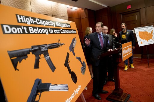 (AP Photo/Andrew Harnik). Sen. Richard Blumenthal, D-Conn., center, accompanied by Sen. Bob Menendez, D-N.J., third from right, speaks at a news conference on an proposed amendment to ban high capacity magazines in guns, on Capitol Hill, Tuesday, Feb. ...