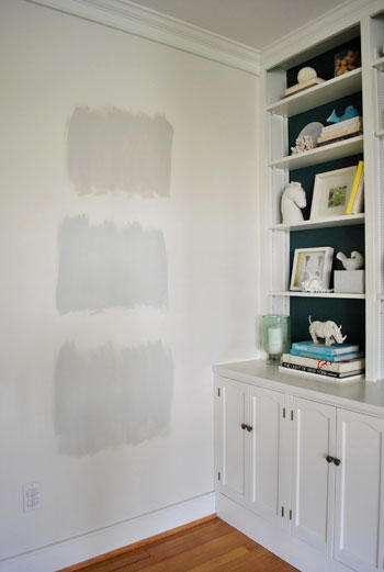 test areas of three Benjamin Moore gray paint colors applies to an area of white wall