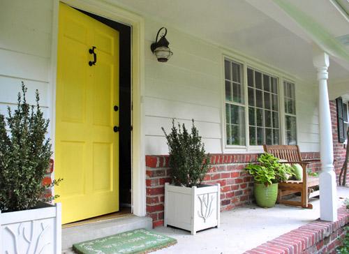 Isnu0027t our porch happier without the old broken maroon screen door + dark hidden front door combo? & How To Paint Your Front Door | Young House Love