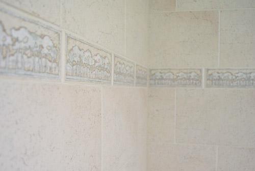 removing an old shower tile border