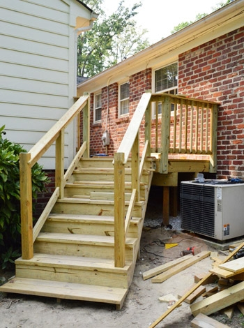 How To Build A Deck It S Done Young House Love   Diy Outdoor Stair Railing   Conduit   Landing   Banister   Cast Iron Pipe   Design