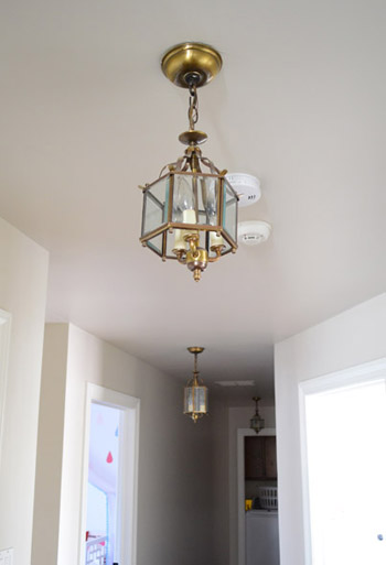 Three oversized lantern lights for the hallway young house love the existing lights were a little undersized for us pictures dont do it justice but this is a 33 foot long hallway so although we considered spray aloadofball Image collections