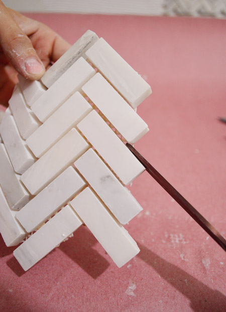 marble herringbone tile backsplash