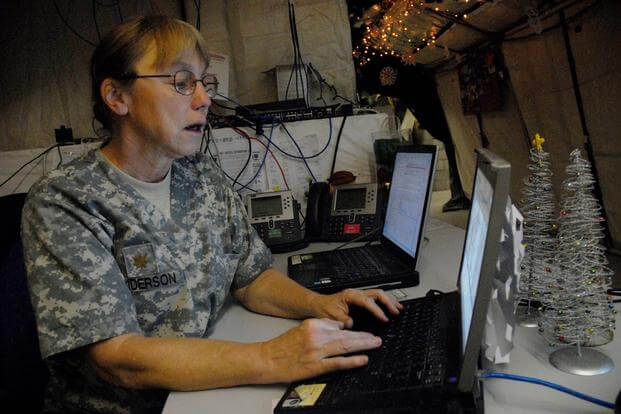 Maj. Catherine Anderson, chief nurse for the 915th Forward Surgical Team, uses MC4, an electronic healthcare record system developed by the military, at the Medical Treatment Facility at Contingency Operating Base Basra., December 31, 2009. (U.S. Army/Pfc. J.P. Lawrence)