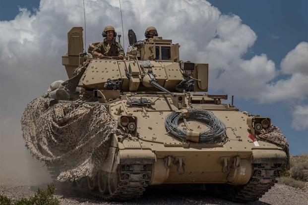 Soldiers from 1st Battalion, 163rd Cavalry Regiment, Montana Army National Guard, push on in their Bradley Fighting Vehicle during a defensive attack training exercise at the National Training Center (NTC) in Fort Irwin, Calif., June 1, 2019 (Cpl. Alisha Grezlik/115th Mobile Public Affairs Detachment)