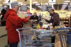 Customers bag groceries at Peterson Air Force Base, Colorado. (U.S. Air Force/Joshua Arends)